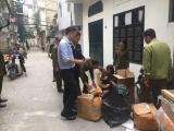 Hà Nội: Bắt quả tang cơ sở cắt mác Trung Quốc để giả mạo Dior, Chanel, Luis Vuiton, Gucci...