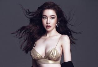 'Gái hai con' Elly Trần tái xuất showbiz, khoe ngực 'khủng'