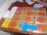 Quảng Nam: Người dân bàn giao 25 bánh Heroin trôi dạt biển Tam Thanh