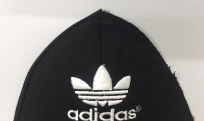 Xử phạt 66 triệu đồng DN sản xuất mũ nhái thương hiệu ADIDAS